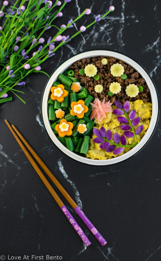 Flower Garden Soboro Bento Box - Learn how to easily make a beautiful flower garden soboro bento that's almost too pretty to eat! Plus, a secret tip that makes decorating even easier. Recipe at loveatfirstbento.com