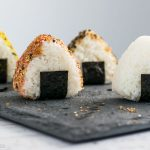 How to Make Onigiri (Rice Balls) - a classic bento recipe, made even simpler with the help of a rice mold. Learn just how easy it is to make this quintessential Japanese lunch item at www.loveatfirstbento.com (video tutorial included!)