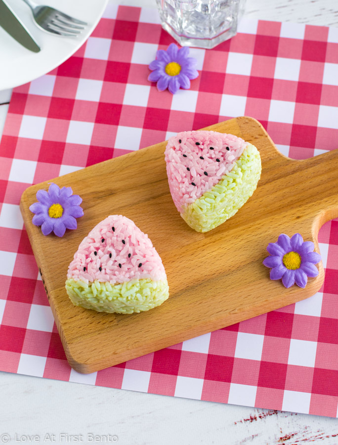Watermelon Onigiri - Fun to make & delicious to eat, watermelon onigiri are the perfect summer bento box or picnic lunch item! Learn how to make these adorable summer rice balls by visiting www.loveatfirstbento.com (includes video tutorial!)