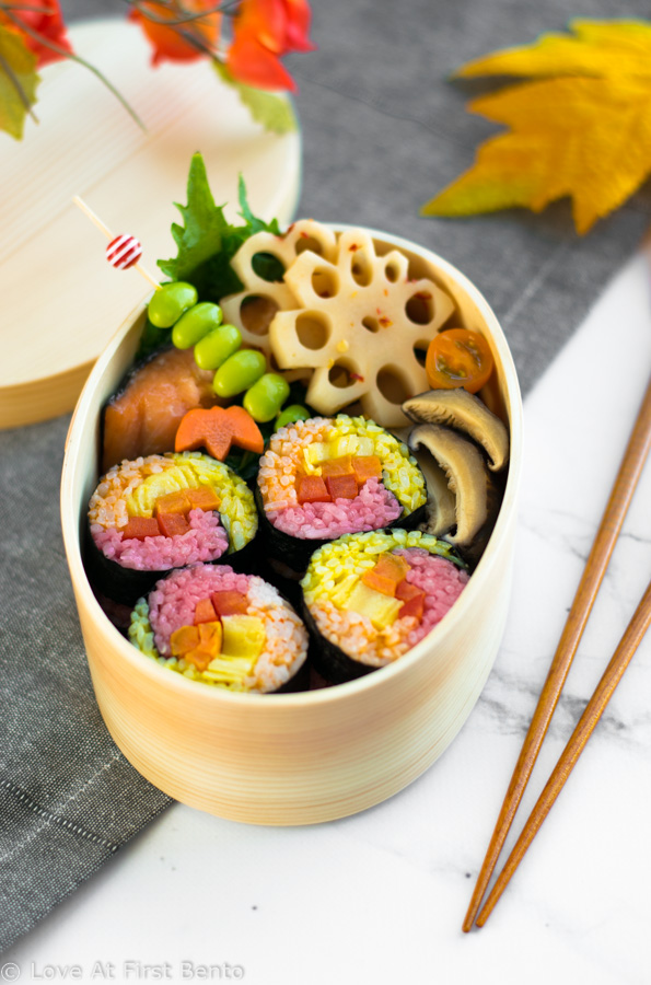 Autumn Colored Sushi - Naturally dyed red, orange, & yellow rice rolled up with your favorite fillings, these sushi rolls are a real showstopper that anyone can master! Step-by-step instructions + video tutorial available at loveatfirstbento.com | fall, bento box, lunch, recipe