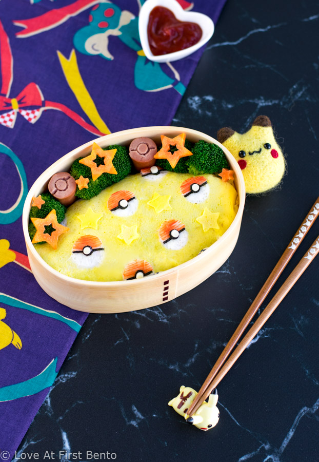 Pokeball Omelette Rice (Omurice) Bento Box - Become a Pokemon master by making this Pokemon themed character bento box for lunch, which includes step-by-step instructions + video tutorial. Perfect for Pokemon fans of all ages! | www.loveatfirstbento.com