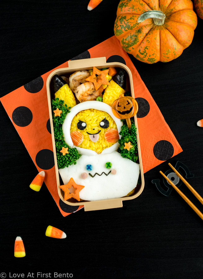 Halloween Pikachu Bento Box - Celebrate Halloween Pokemon style by making this adorable Halloween Pikachu character bento! Step-by-step instructions + video tutorial reveal how to get perfectly yellow rice & easily shape your rice into the perfect Pikachu. | loveatfirstbento.com {kyaraben, lunch, onigiri}