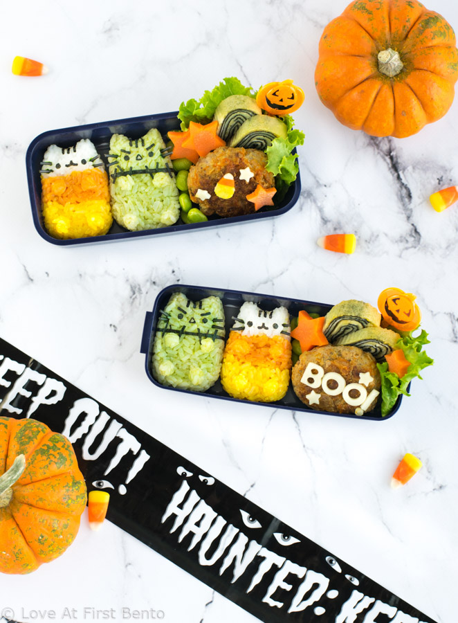 Halloween Pusheen Surprise Bento Box - Now you can experience the fun of the Halloween Pusheen Surprise Box in your lunch, thanks to this cute & festive character bento box! Learn step-by-step how to make Candy Corn Pusheen & Frankenstein Pusheen using a rice mold + all natural dyes - video tutorial included! | loveatfirstbento.com
