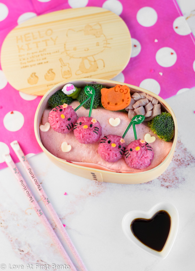 Hello Kitty Cherry Bento Box - The perfect lunch for any Hello Kitty fan, this pink & girly bento is so easy to make, it's nearly foolproof, making it perfect for beginner bento makers. Along with step-by-step instructions & video tutorial, find out the amazing tool I use to easily shape perfectly circular rice balls in just 30 seconds!!   loveatfirstbento.com [character bento, kyaraben, charaben, vegetarian]