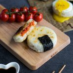 Roasted Tomato Yaki Onigiri with Fried Egg - The ultimate in lunchtime decadence! Toasty golden rice, sweet roasted tomatoes, and a runny fried egg transform your average rice ball into an irresistibly mouth-watering treat! Find out the one common kitchen tool used to make these circular onigiri - I guarantee it's in your kitchen drawers right now! Get this delicious & easy recipe at loveatfirstbento.com | bento box, Japanese food, grill