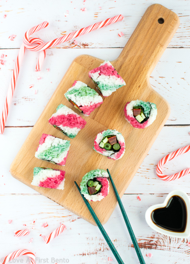 Candy Cane Sushi Rolls - These beautiful uramaki (inside-out) rolls are 100% vegan, and get their colorful stripes from all-natural homemade dyes. Step-by-step video tutorial + tips & tricks will have you rolling out these fun & colorful sushi rolls with ease! Perfect for Christmas bento boxes and holiday party appetizers. | loveatfirstbento.com