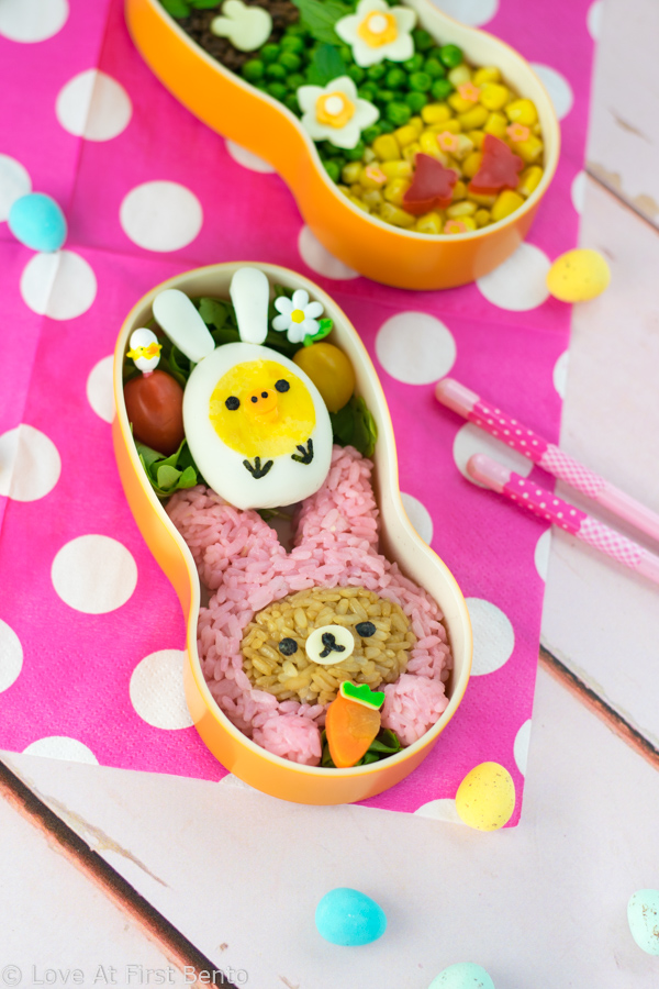 Bunny Rilakkuma Easter Bento - Learn how to turn Rilakkuma & Kiiroitori into adorable Easter bunnies, using naturally dyed rice, onigiri molds, and hard-boiled eggs. A guaranteed lunchtime hit for Rilakkuma fans of all ages! Get the recipe at: loveatfirstbento.com {character bento box, kyaraben, rabbit}