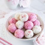 Salted Rose Onigiri - WOW your friends with the unique flavor of pickled rose petals, which take these rice balls to a whole new level of edible elegance! Plus, I reveal a super easy, 2-ingredient rose salt recipe perfect for sprinkling on top. These onigiri are absolutely perfect for a Mother's Day or spring bento box - a guaranteed crowd-pleaser! Get the recipe at loveatfirstbento.com