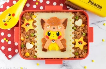 Vulpix Pikachu Bento Box - Pokemon fans will FLIP over this insanely adorable Pokemon bento, which features Pikachu dressed up as a Vulpix! 100% edible & perfect for decorating rice, this bento can easily be created by anyone thanks to my 'secret hack' for easily & accurately creating images out of food. Get the recipe at: loveatfirstbento.com [character bento, kyaraben, lunch]