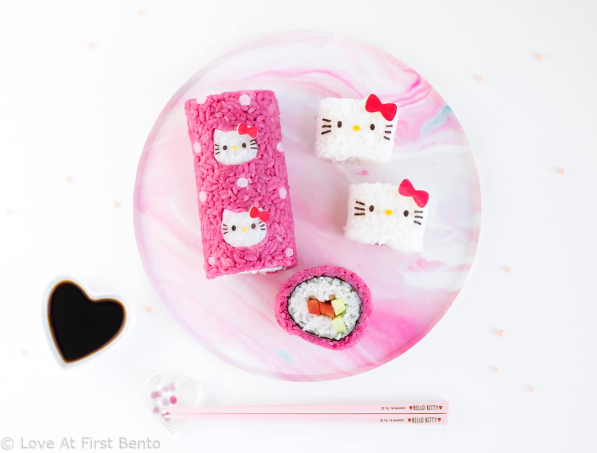 Hello Kitty Sushi Party - The perfect way to celebrate International Sushi Day! These 5 adorable Hello Kitty sushi designs are a Hello Kitty fan's dream come true, and a truly almost too cute to eat! Even complete beginners can learn how to make these Hello Kitty sushi from start to finish - find out how by visiting loveatfirstbento.com