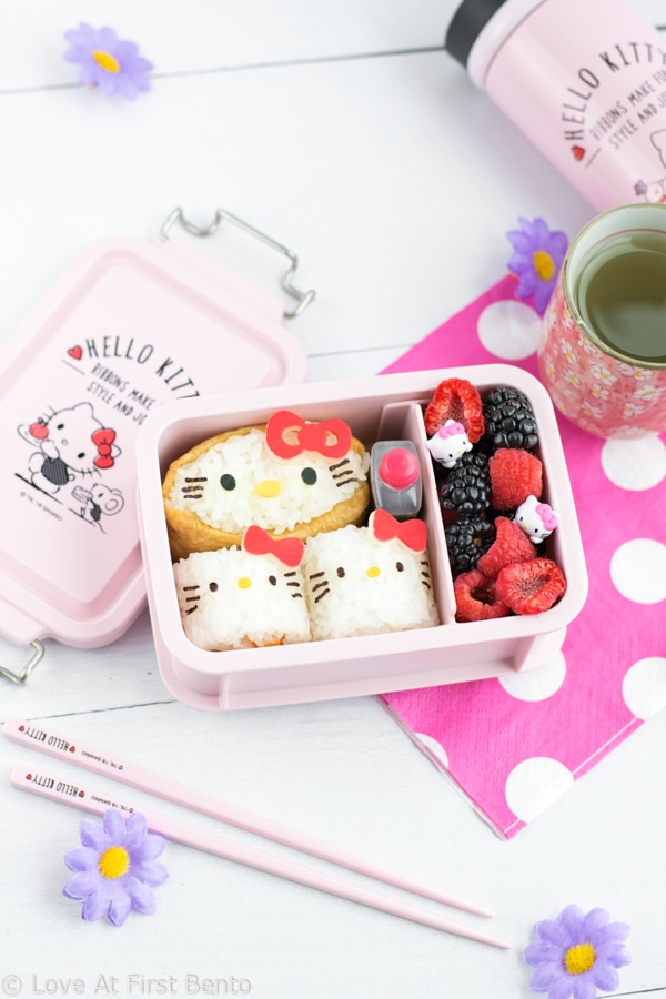 Hello Kitty Sushi Party Bento - The perfect way to celebrate International Sushi Day! These 5 adorable Hello Kitty sushi designs are a Hello Kitty fan's dream come true, and a truly almost too cute to eat! Even complete beginners can learn how to make these Hello Kitty sushi from start to finish - find out how by visiting loveatfirstbento.com
