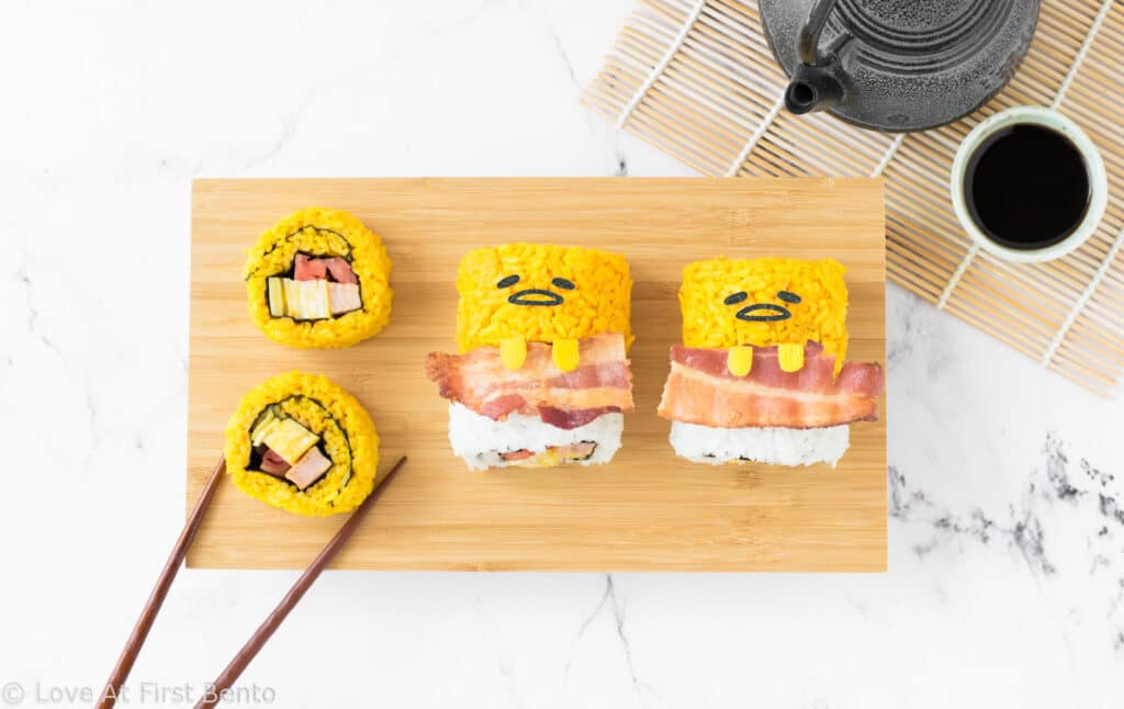 Gudetama Sushi - These bright yellow Gudetama sushi rolls will make Gudetama fans FLIP! Easy to make, and colored using all-natural ingredients, these make for the most perfect and tasty sushi ever! Get the recipe at: loveatfirstbento.com [sushi, egg, bento, lunch}
